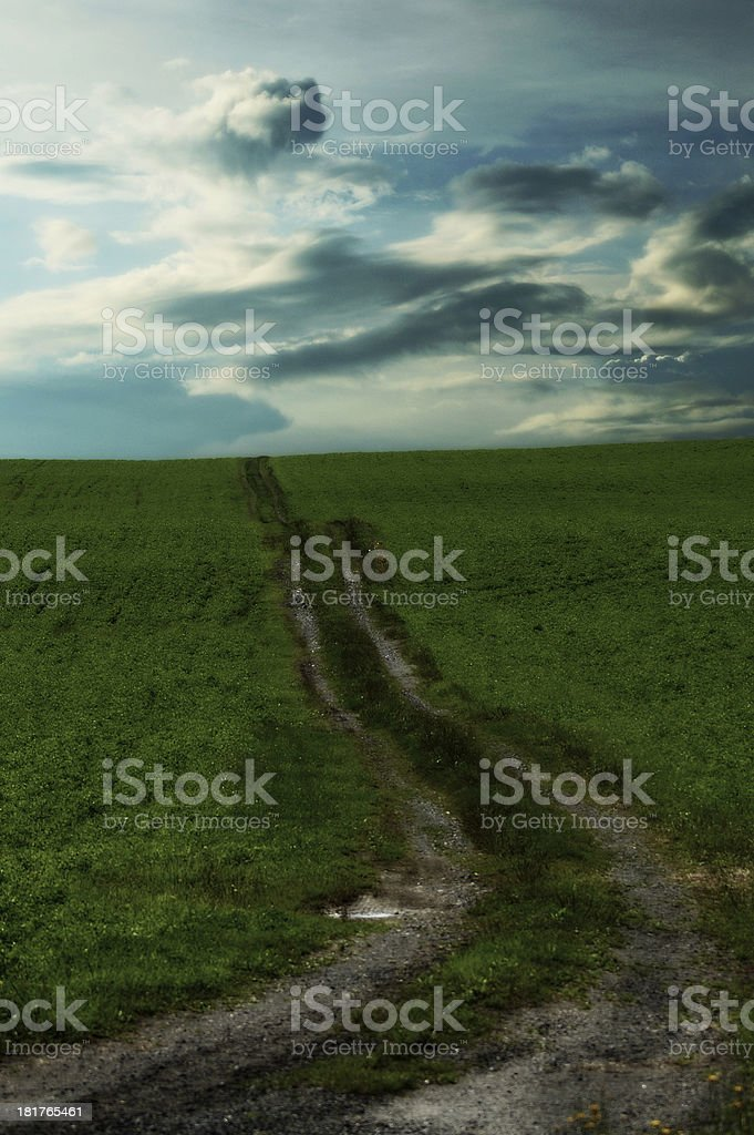 Mountain roads grass, coudy sky royalty-free stock photo