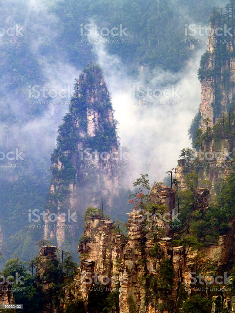 Mountain Rocks in Sea of Clouds stock photo
