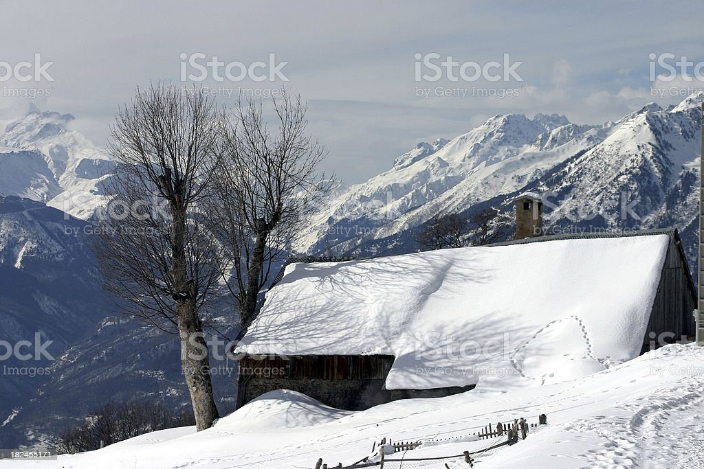 Mountain shelter in front of Alps landscape stock photo