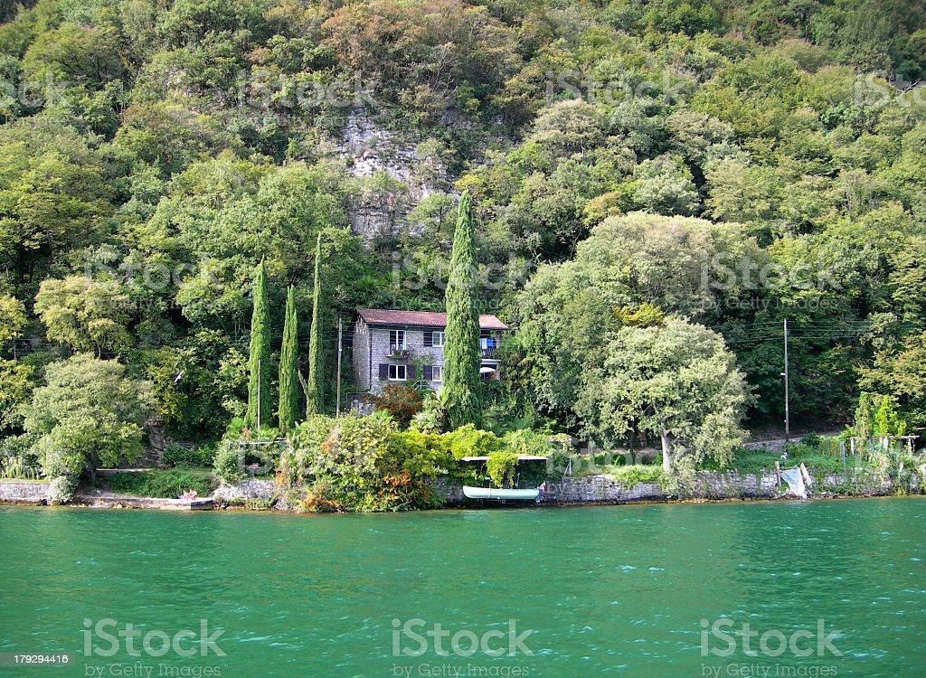 Mountain side house on lake royalty-free stock photo