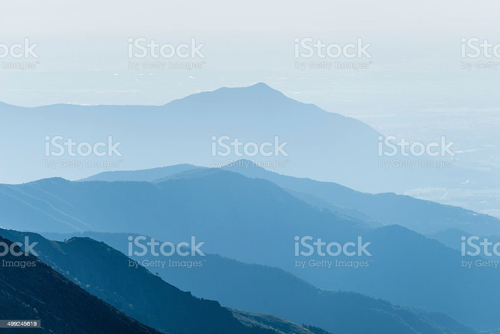 Mountain silhouette at sunrise stock photo