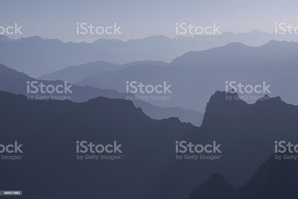 Mountain silhouettes stock photo