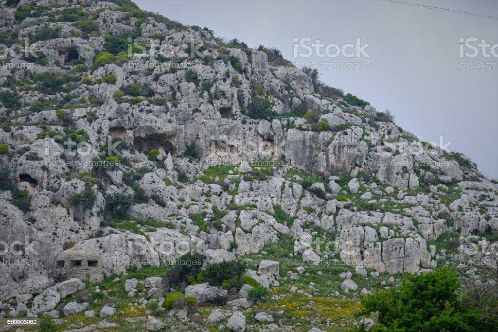 Mountain slope, white stone and vegetation at dusk stock photo