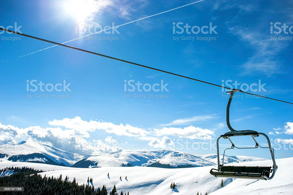 Mountain slopes with chairlift on a winter sunny day stock photo
