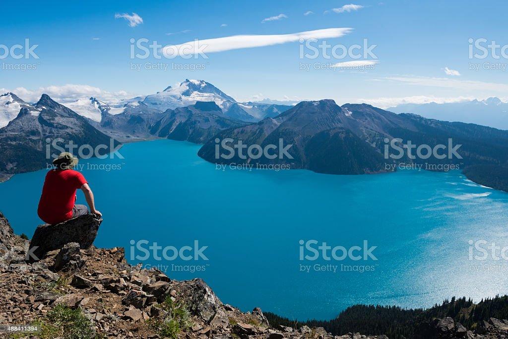 Mountain Solitude at an alpine galcial lake stock photo
