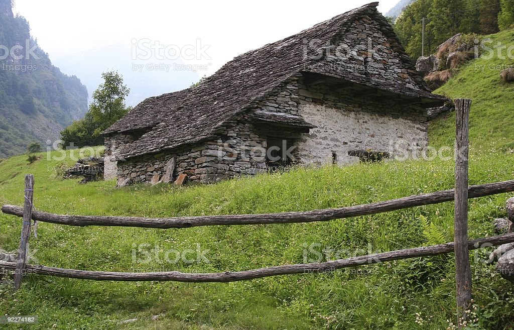 mountain stone house in the Swiss Alps royalty-free stock photo