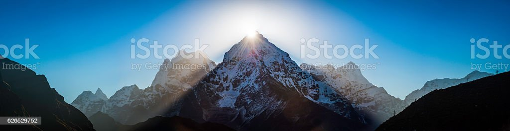 Mountain sunburst dramatic sunrise over Himalaya peaks panorama Khumbu Nepal stock photo