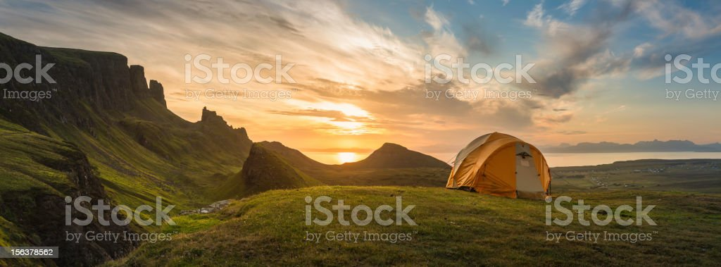Mountain tent sunrise dawn on idyllic camp panorama stock photo