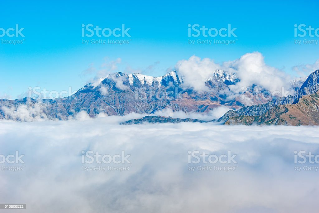 Mountain top above the clouds. stock photo