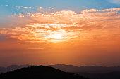 mountain top in sunset glow