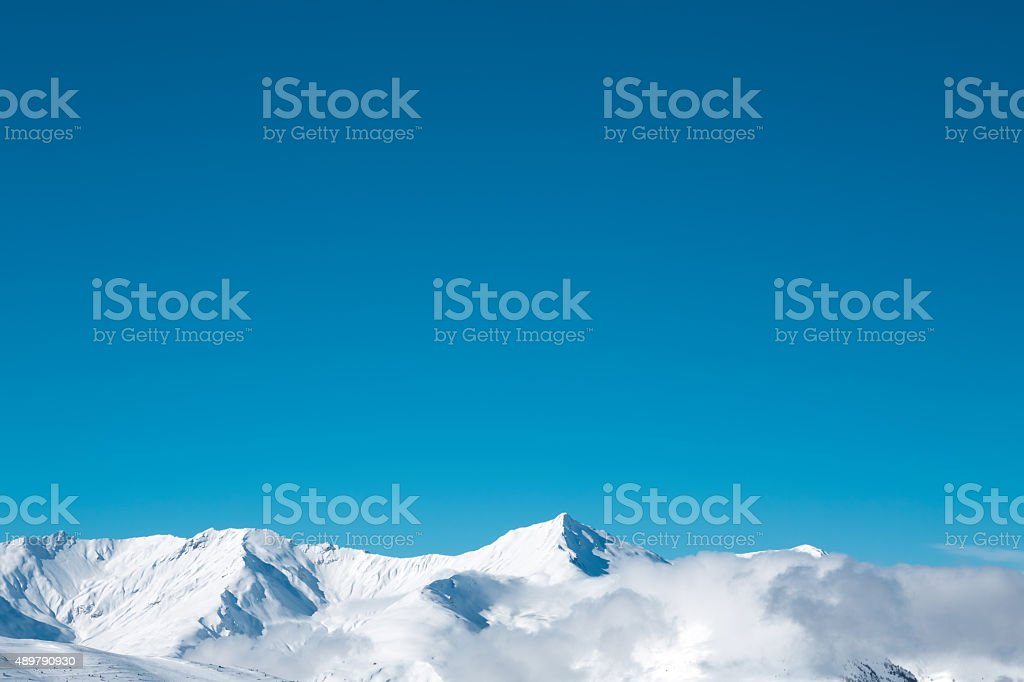 Mountain Top Looking Out Of The Fog After The Snowfall stock photo