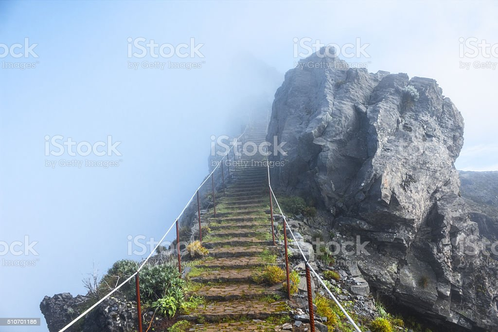 mountain trail in Madeira above the clouds stock photo