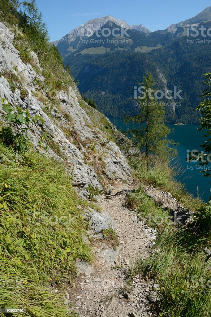 Mountain trail nearby St Bartholoma church at Koenigssee lake. stock photo