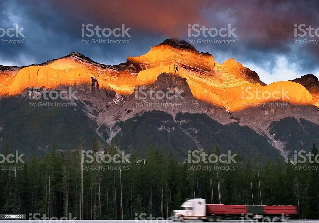 Mountain Trucking at Sunrise stock photo