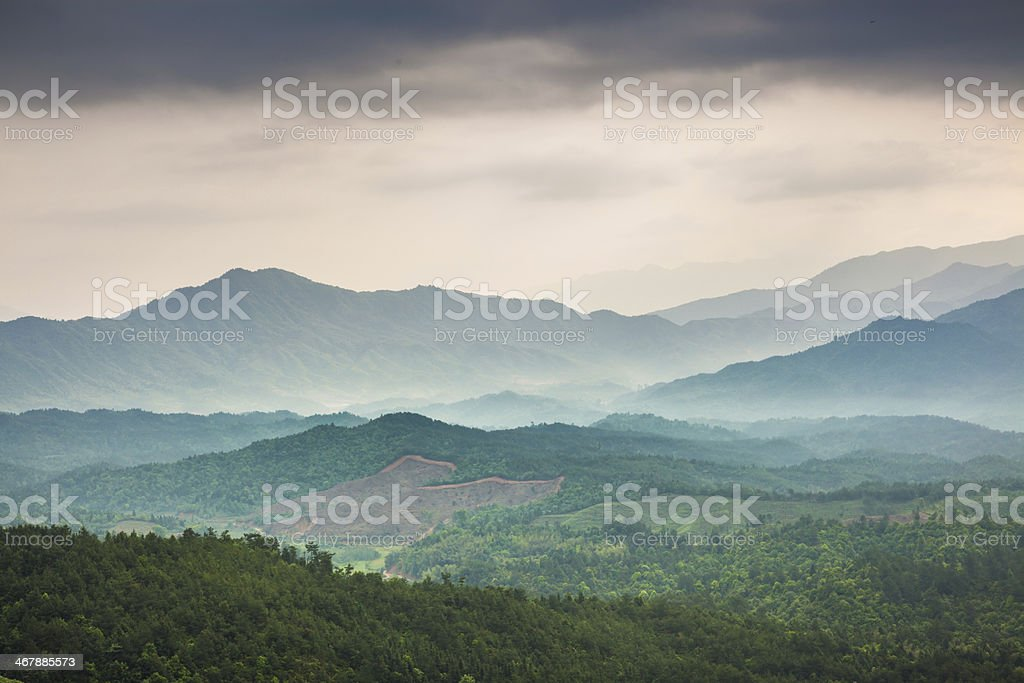 Mountain under mist in the morning stock photo