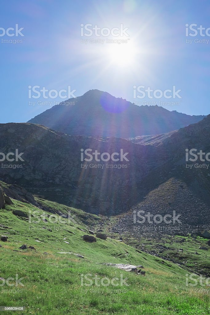 Mountain valley and backlit sun stock photo