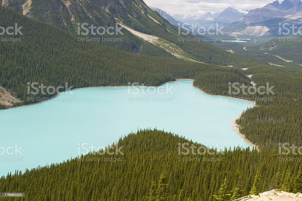 Mountain valley with cyan glacial lake royalty-free stock photo