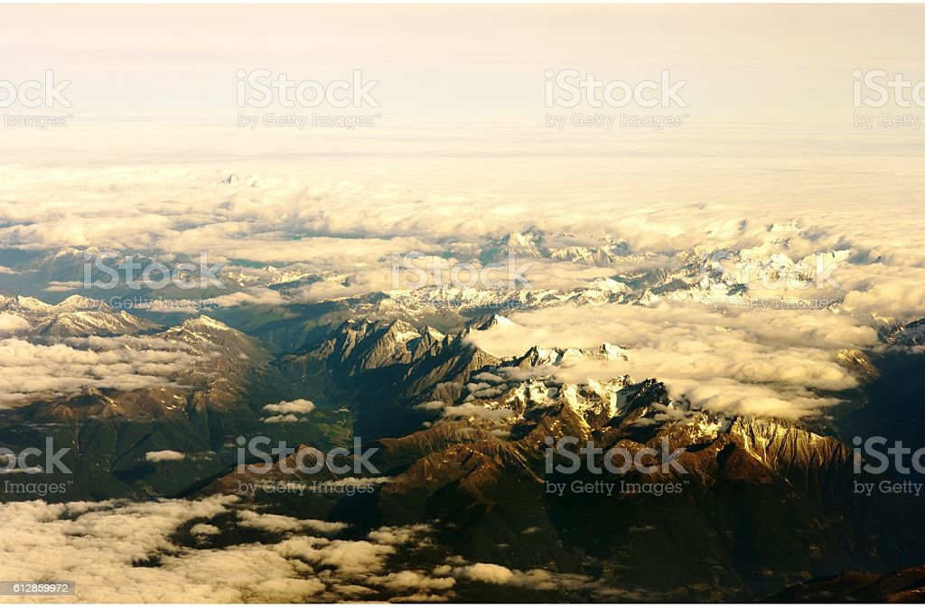 Mountain view from the top through the clouds stock photo