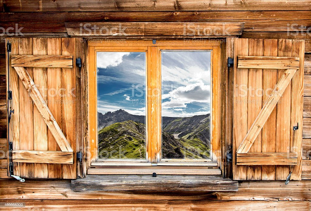 Mountain view from the window of a cabin on a mountaintop  stock photo
