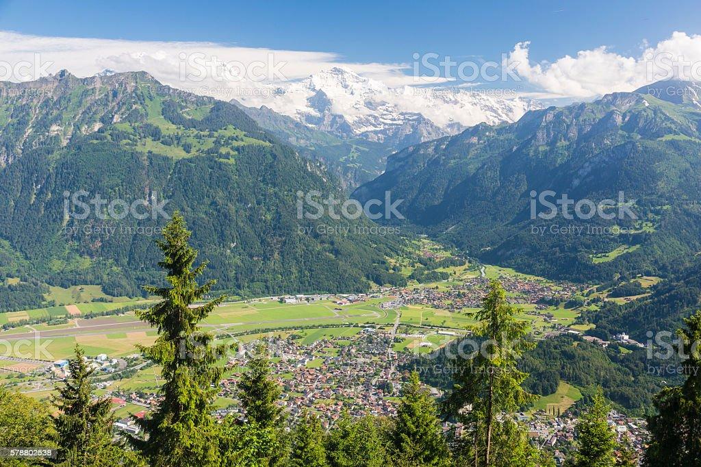 mountain view to city Interlaken and mountain Jungfrau in Switzerland stock photo