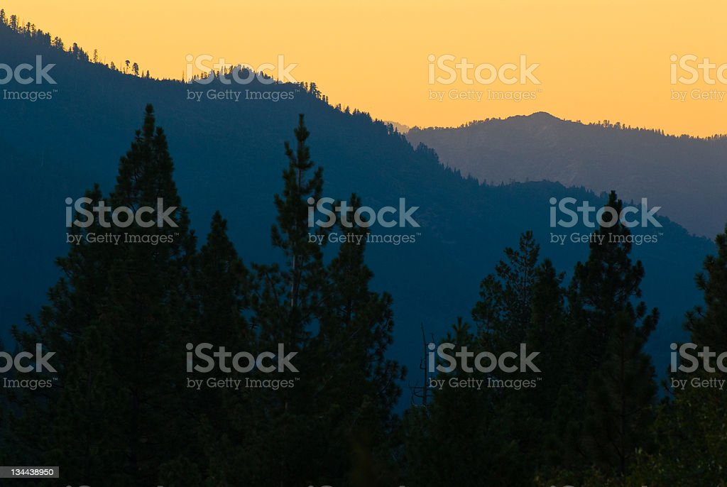 Mountain View with Silhouetted Hills Trees and Forest in Yosemite royalty-free stock photo