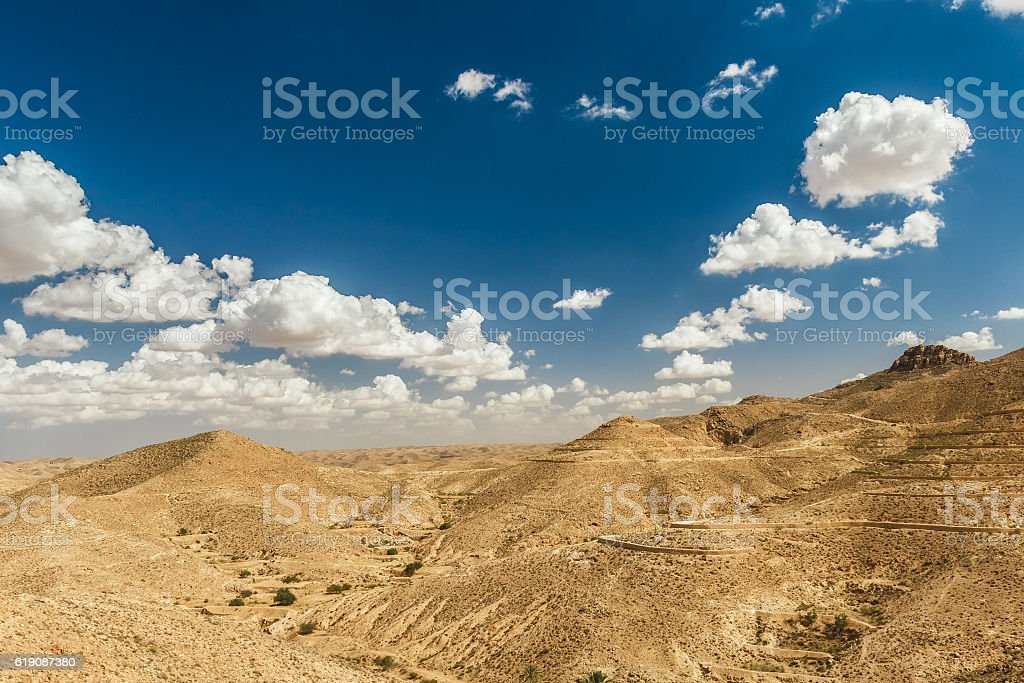 Mountain views in the desert. Tourists on top of a stock photo