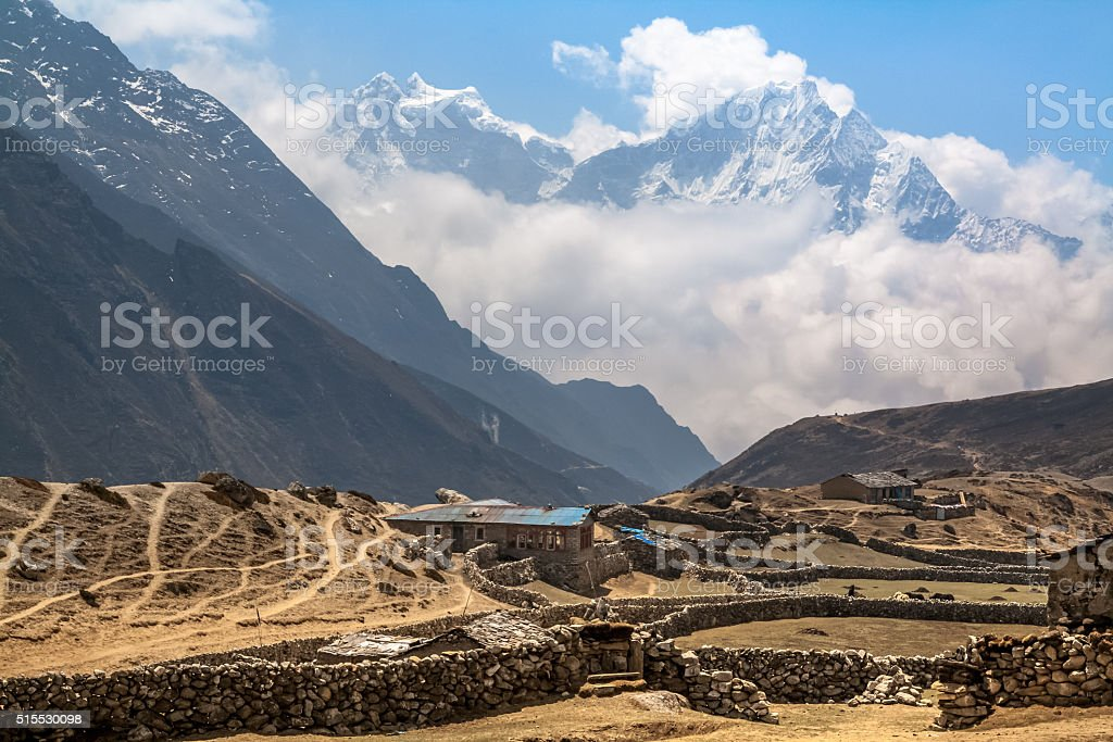 Mountain village under the snow-capped peaks in Gokio Valley. Himalayas. stock photo