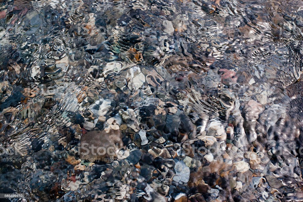 mountain water and river pebbles detail stock photo