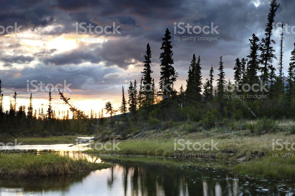 Mountain Water Hole at Sunset stock photo