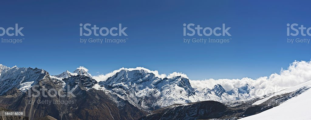 Mountain wilderness horizon panorama snow peaks Himalayas stock photo