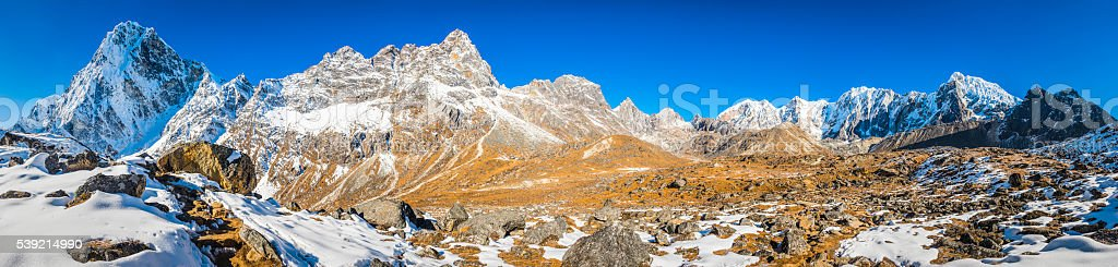 Mountain wilderness panorama snowy summits dramatic peaks pinnacles Himalayas Nepal stock photo