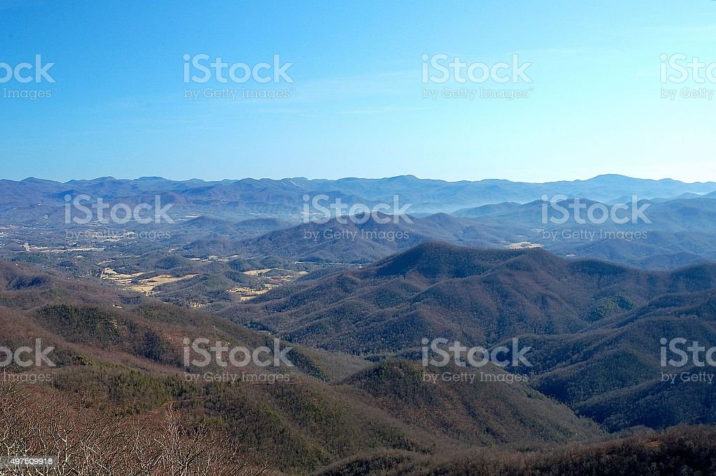 Mountain winter landscape with small town in the valley stock photo