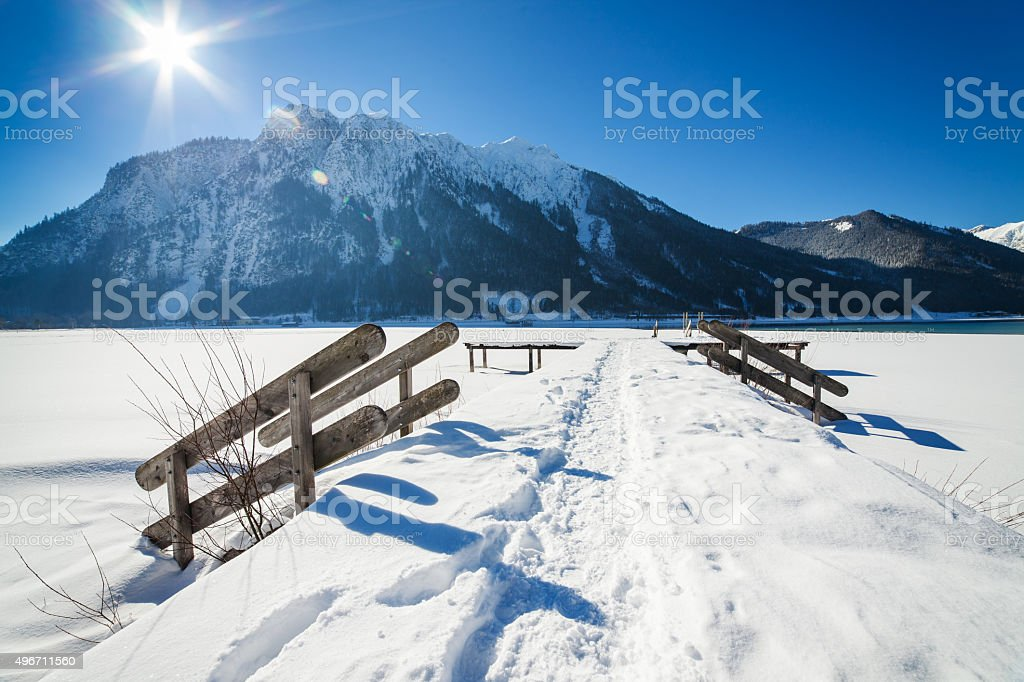 Mountain winter landscape with wooden stairs covered with snow stock photo