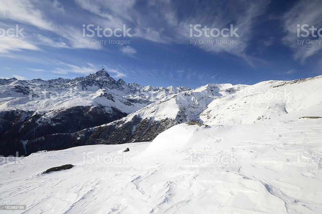 Mountain winter scene in a windy day royalty-free stock photo