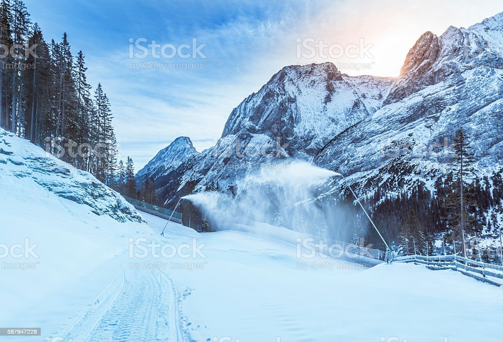 Mountain winter with snow cannons stock photo