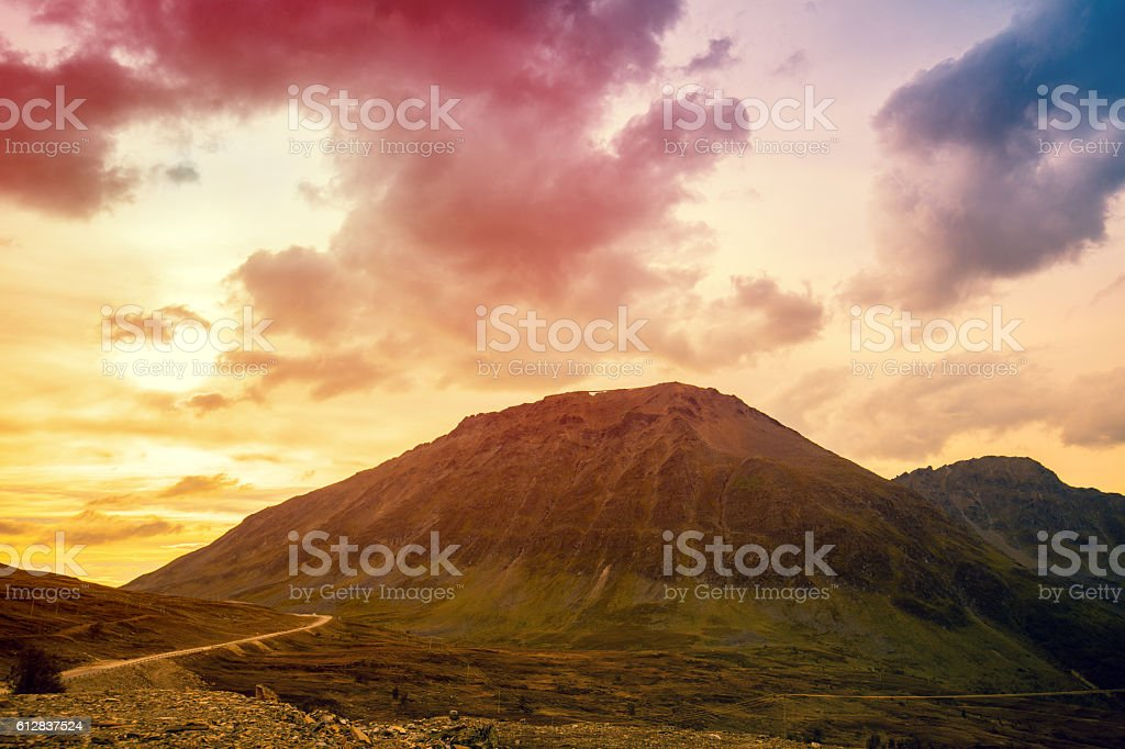 Mountain with colorful cloudy sky at sunset stock photo