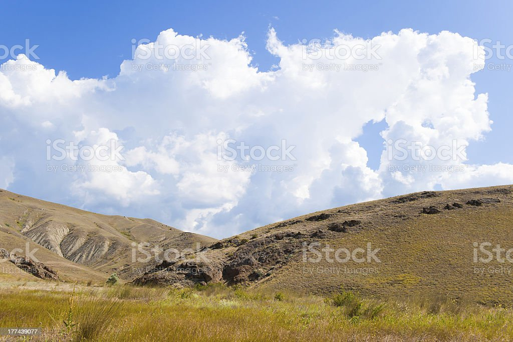 Mountain with majestic clouds royalty-free stock photo