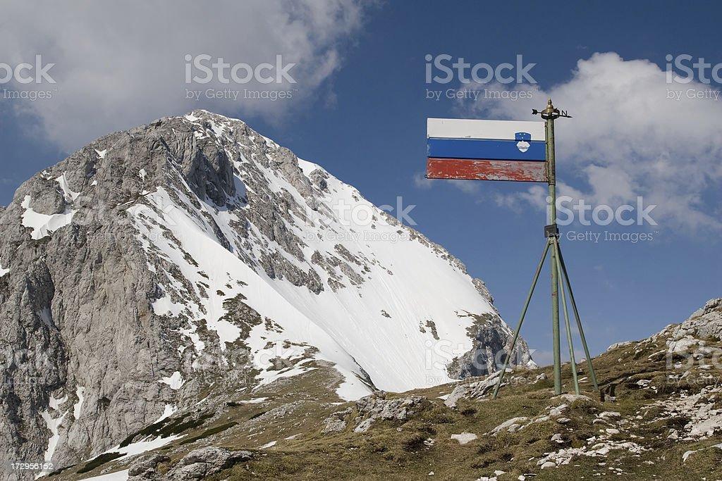 Mountain with Slovenian flag stock photo