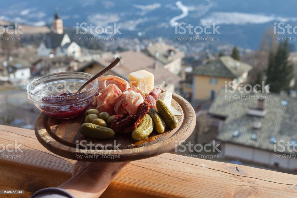 Mountain wooden plate of italian lunch stock photo