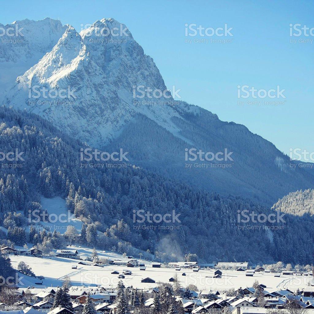 Mountain Zugspitze and idyllic Garmisch-Partenkirchen stock photo