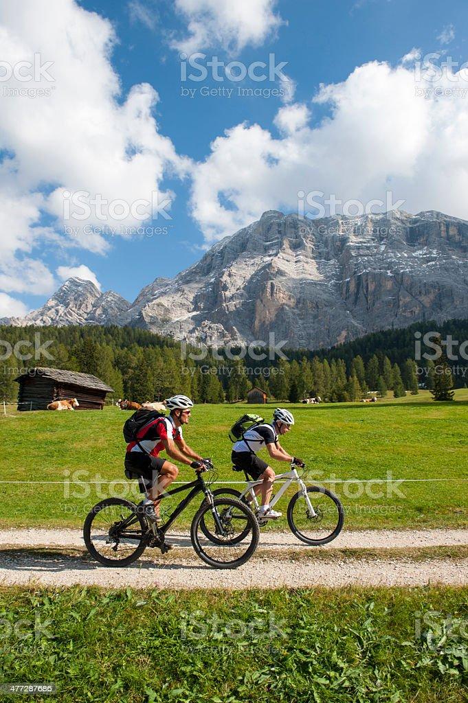 mountainbike downhill in the dolomite mountains stock photo