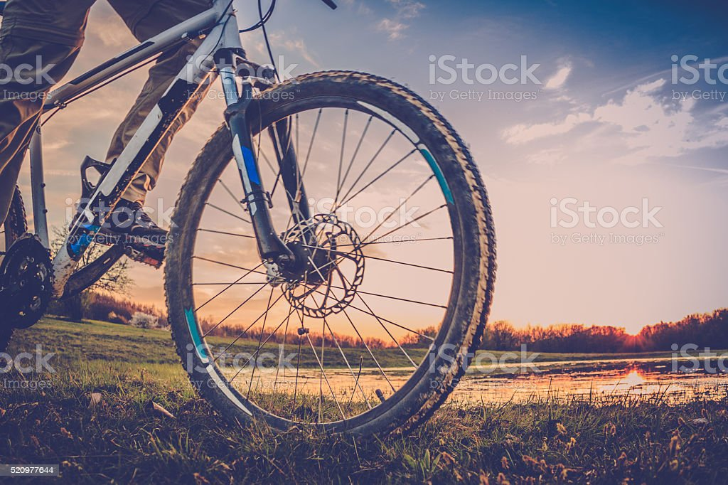 Mountainbiker at sunset stock photo