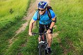 Mountainbiker climbing the mountain