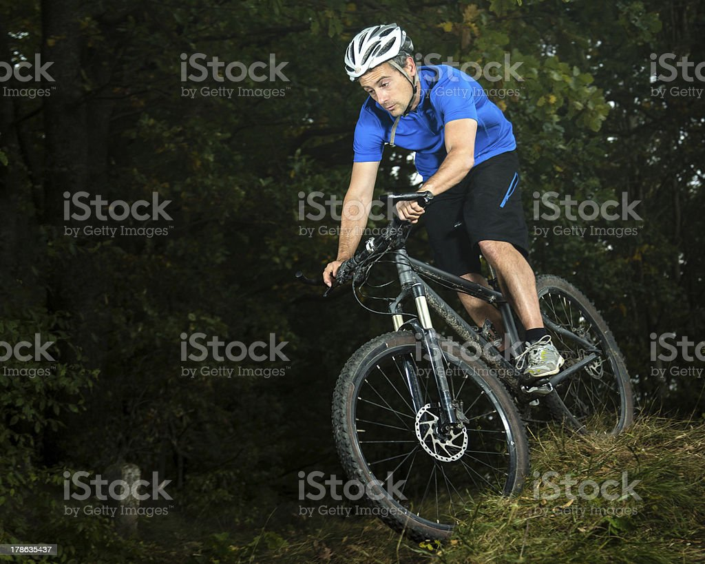 mountainbiker in a downhill royalty-free stock photo