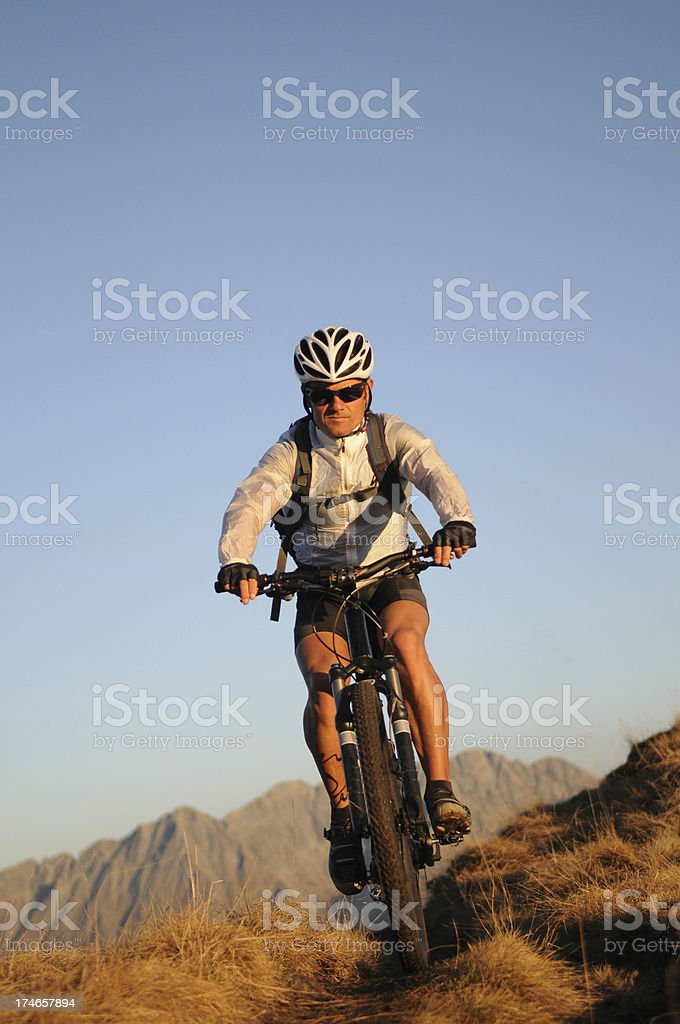 Mountainbiker in the rocky mountain royalty-free stock photo