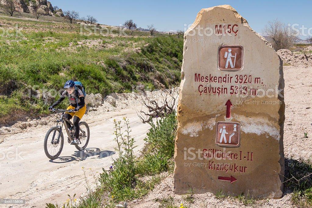 Mountainbiker is finding the right way in Cappadocia, Turkey stock photo