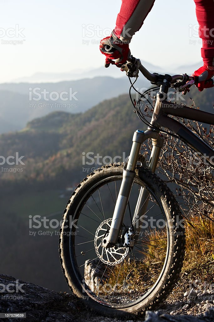 Mountainbiker on bike with mountains in background royalty-free stock photo