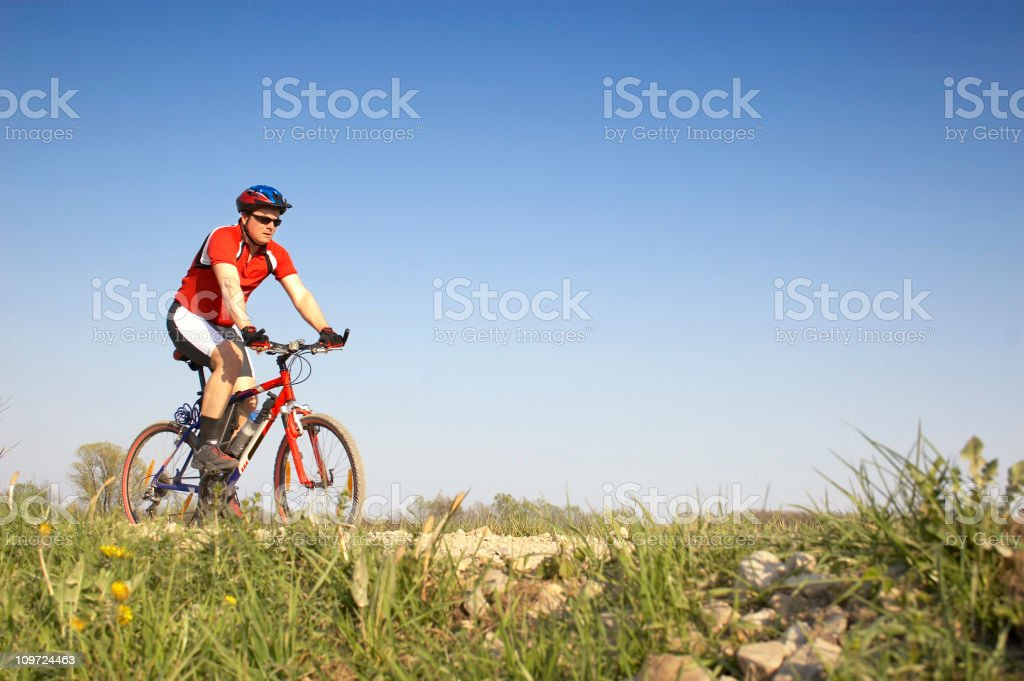 Mountainbiker on mountain bike in scenic shoot royalty-free stock photo