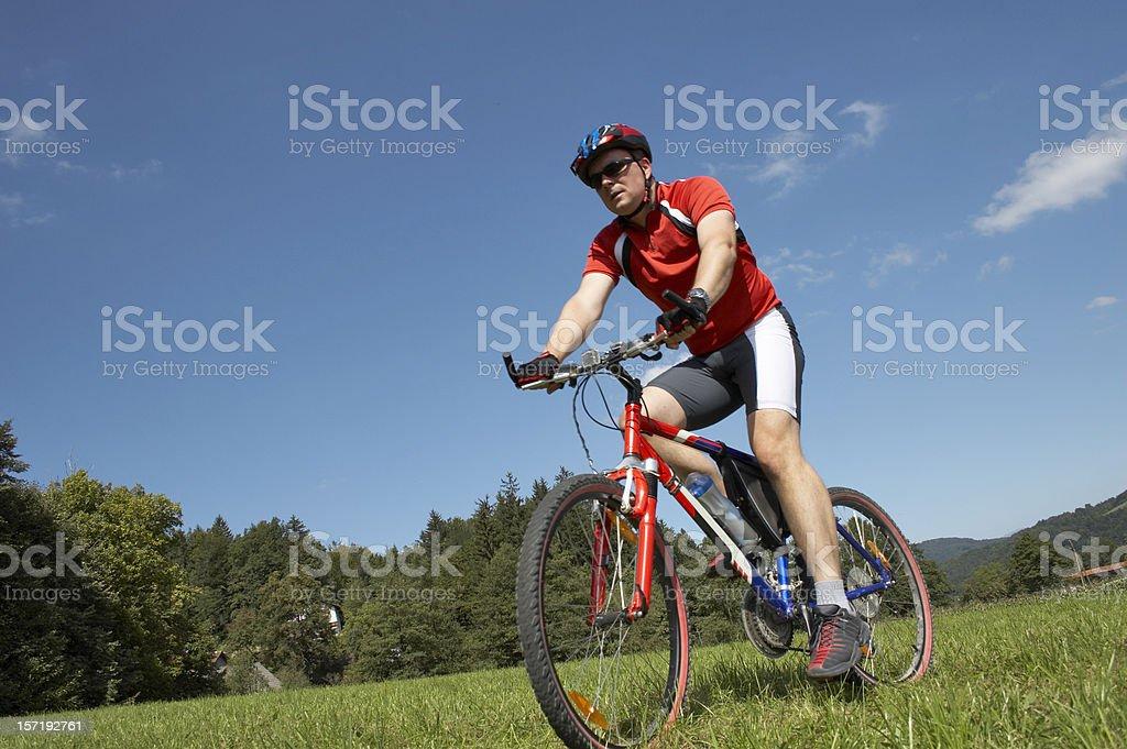 Mountainbiker on mountain bike in scenic shoot royalty-free stock photo