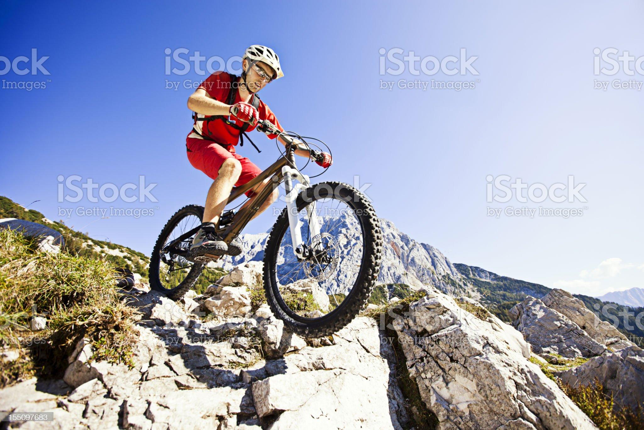 Mountainbiker on steep trail royalty-free stock photo